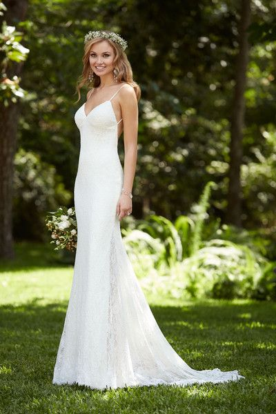 Lace and Imperial crepe sheath wedding dress with sexy spaghetti straps and a low back. The skirt features two side splits, showcasing a sheer panel of lace on each side. The back zipper is hidden under fabric {Dress by Stella York by @essensedesigns}