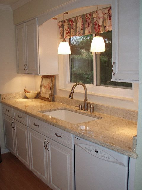Tiny Galley Kitchen by Niesz Vintage Fabric, via Flickr. Like the deep sink, the counter color, and the lighting