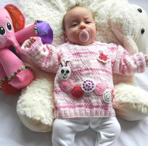 Dětský růžovobílý svetřík s housenkou