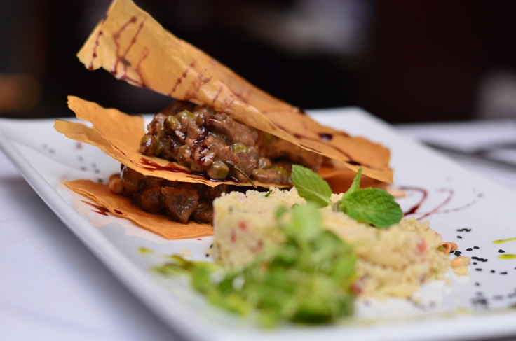 Venison Mille Feuille with a side of fresh mint couscous served @ Angie's World Cuisine in Coral Gables, FL