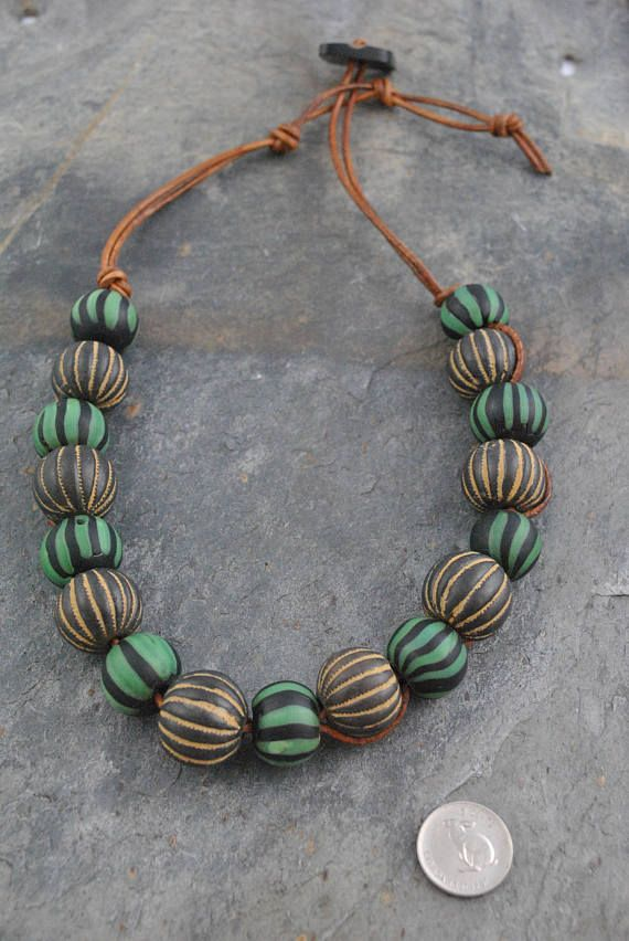 African Trade Bead Striped Recycled Glass & Pottery Artisan Necklace #single #singlestrand #tribal #tribalstyle #boho #bohemian #african #trade #tradebeads #africantradebeads #leather #cord #leathercord #recycled #recycledglass #glass #pottery #striped #navy #blue #green #brown #rustic #oversized #artisan #artisannecklace #necklace #handmade #oneofakind