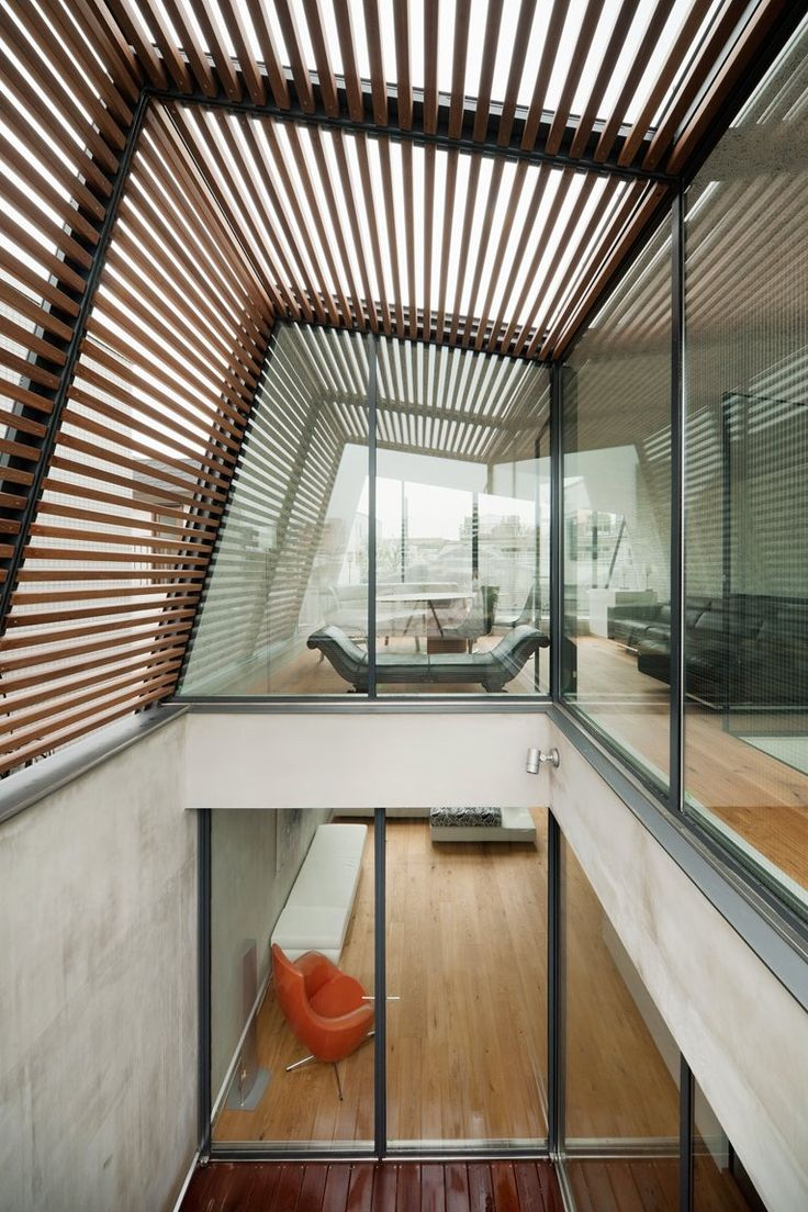 Incredible wood slatted glass roof filters light into the room