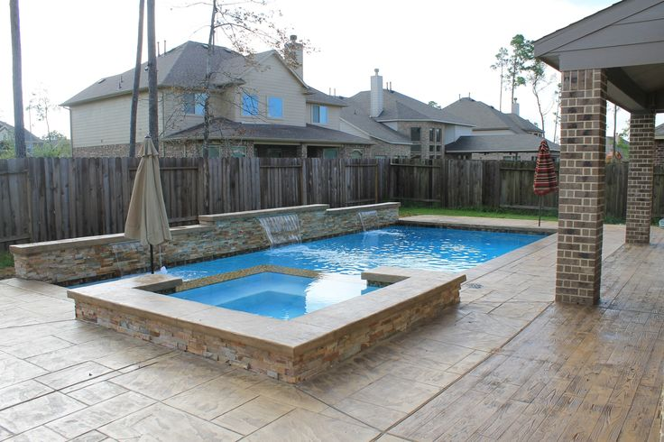 "Geometric rectangular pool with vanishing edge or known also as infinity edge spa 1""x1"" glass tiles diamondbrite - Super Blue - Raised wall with ledger stone - sheer descents - Concrete cantilever edge, stamped concrete - Texas Aquatics & Pool Services - Houston, Texas and surrounding areas 281-852-5630 www.thetexasaquatics.com North Houston, Humble, The Woodlands, Kingwood, Conroe, Spring, Porter, Huffman"