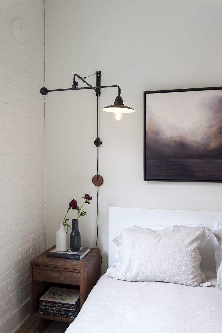overhead task lamp lighting mounted as a sconce in bedroom. great for reading