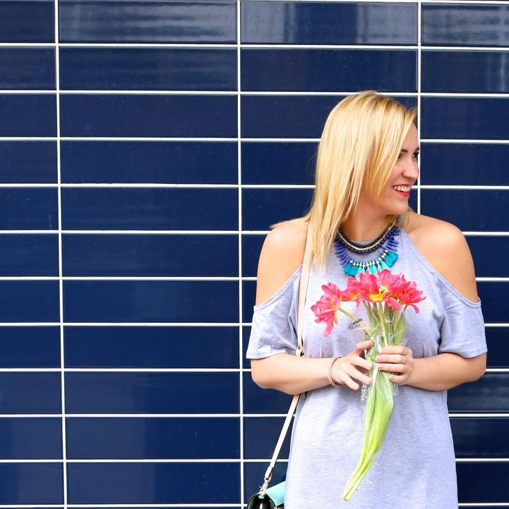 a cold shoulder shirt dress, vibrant blue fringe necklace and flowers! Who could ask for more?