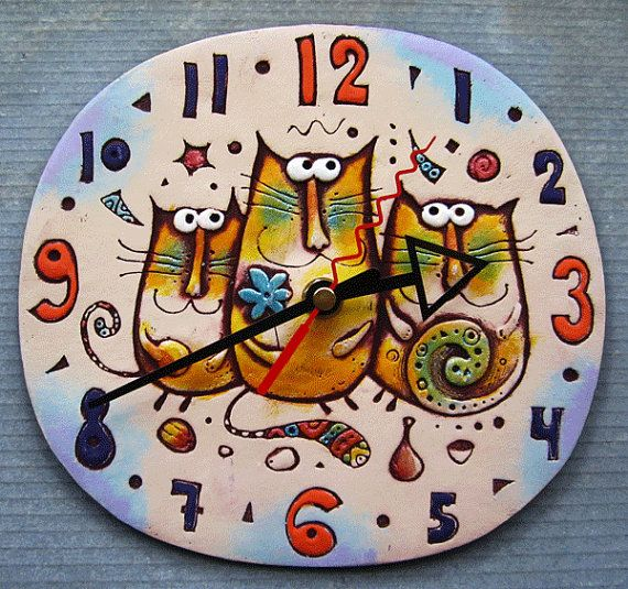 Ceramic wall clock Cat Family. This is an own work. Size 18,5x17,5 cm. We ship our works worldwide, shipping can take from 15 to 30 days.