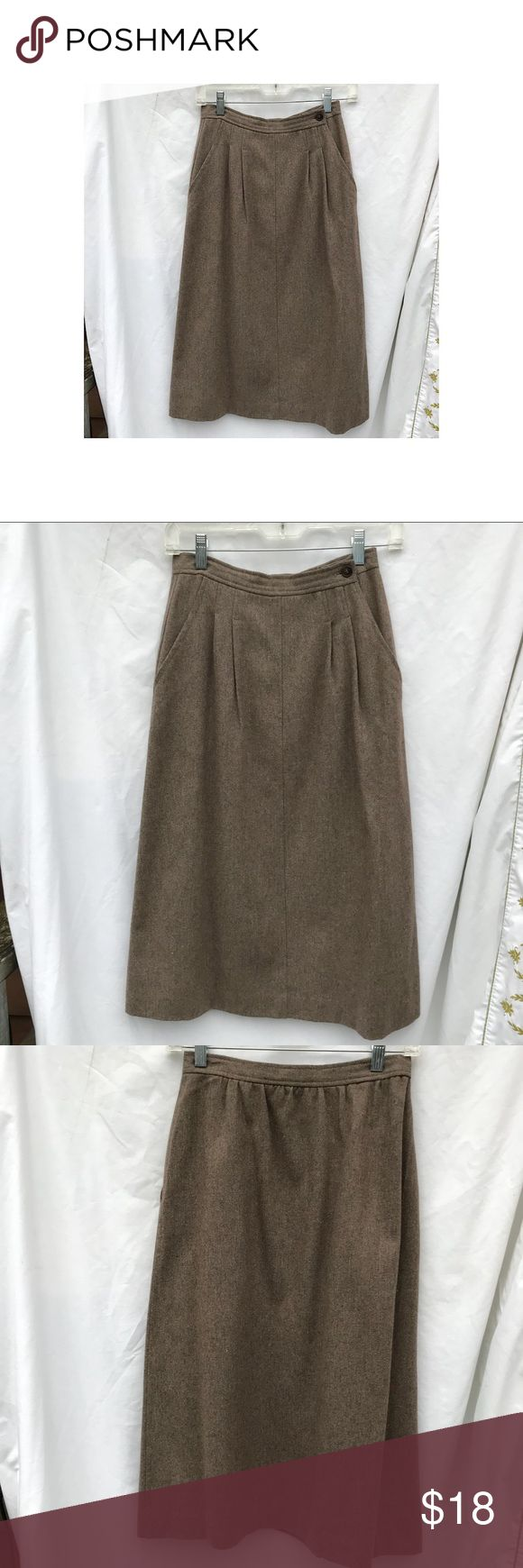 """1980's Vintage Secretary Wool Skirt, light brown This is s perfect vintage work skirt.  Fully lined with a wool fabric slightly varied in color it will go with many things.  The top stitched pleats provide for easy sitting without adding bulk to the waist.    The flare of the skirt also means that you can walk!  Nice!  The only tags say dry clean only and size 6.  Waist:  26"""" Length:  29"""" unknown Skirts A-Line or Full"""