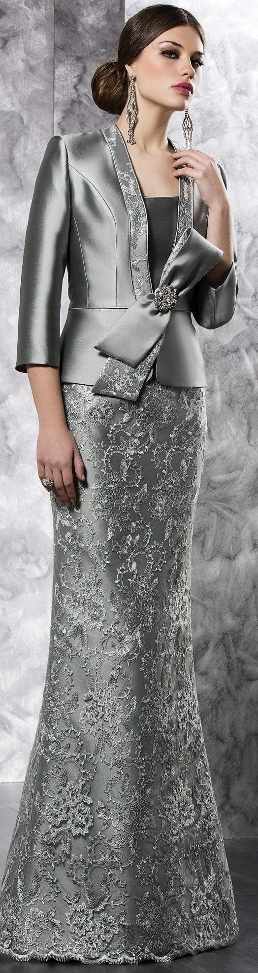 Grey mother of the bride evening dresses can have beaded lace skirts. This design shows a beautiful satin jacket with 3/4 length sleeves. We can produce custom mother of the bride evening gowns similar to this haute couture piece but for an affordable price. Get pricing on any #motherofthebride dress design in a picture at www.dariuscordell.com