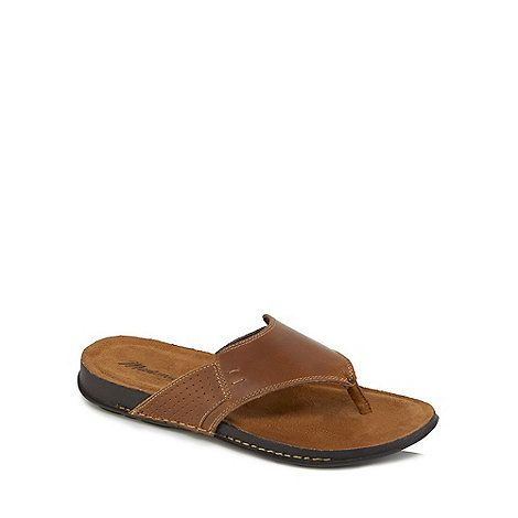 These sandals from Mantaray will add a comfortable and practical touch to a footwear collection. Created in a brown hue, they feature seam detailing and a thick strap across the bridge. They come complete with a toe-post and a black rubber sole for added comfort and a secure fit.