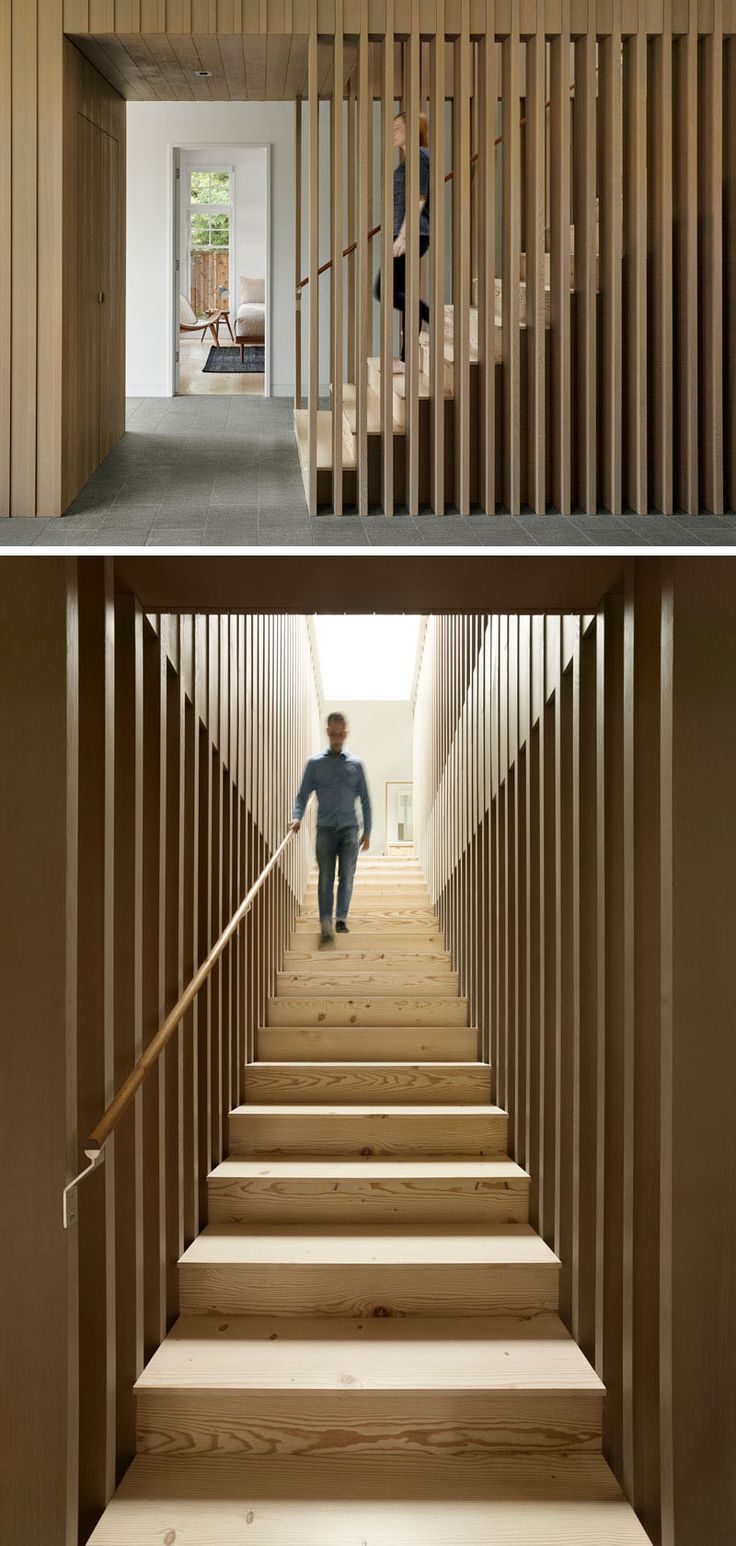 These modern stairs are surrounded by wood slats that don't block the light. There's also a skylight to keep the stairwell bright.