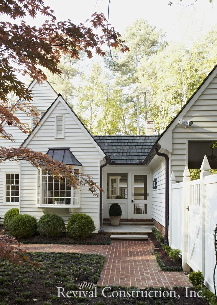 White weatherboard with black trim by Revival Construction