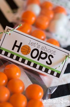 a fun printable collection for your basketball player!  perfect for end of the season team parties, March madness, coaches and team gifts and so much more!    these cello bag toppers filled with orange gumballs from SweetWorks are a fun and tasty treat!