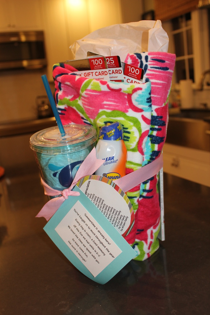 Gift cards, beach towel, insulated cup, magazine & sunblock...nice presentation for gift cards. I wrote a little poem and listed the families that contributed.