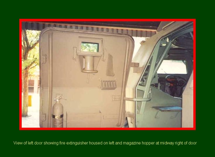 SADF.info RATEL 20 & 90 INTERIORS view of left door showing fire extinguisher housed on left and magazine hopper at midway right of door