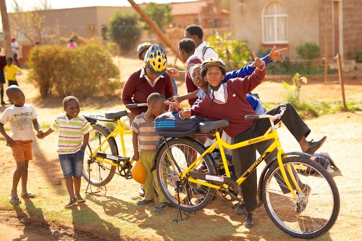 What a Qhubeka bicycle handover looks like in Orange Farm, South Africa