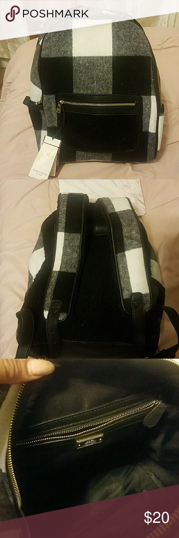 Adam lippes for target backpack Black and white plaid back pack. The back of the back pack is black faux Shearling. Wool like material. Adjustable straps. About 14 inches long 11 1/2 wide. Adam Lippes For Target Bags Backpacks