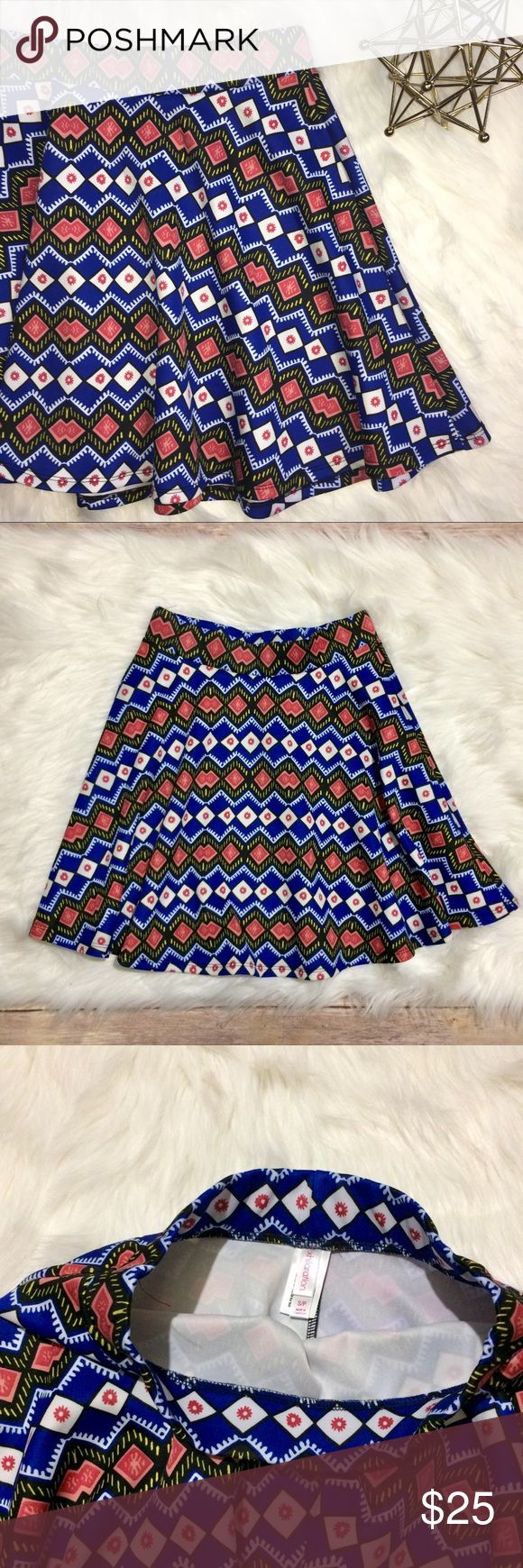 Xhilaration Tribal Print Skirt 🌟 Super cute tribal print skirt from Xhilaration. Skirt is size S. Fabric content is 93% Polyester and 7% Spandex.   Measurements approximately:  🌺 Waist: 26 inches and does have some stretch Xhilaration Skirts