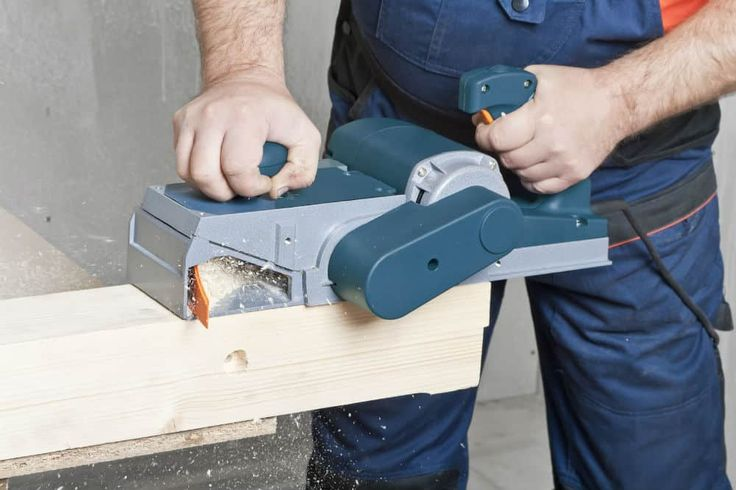Man learning How To Use An Electric Planer