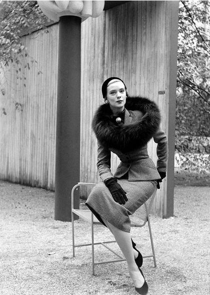 Barbara Wood models a tailored tweed suit with black fox circle by Omar Kiam, photo by Nina Leen, 1950