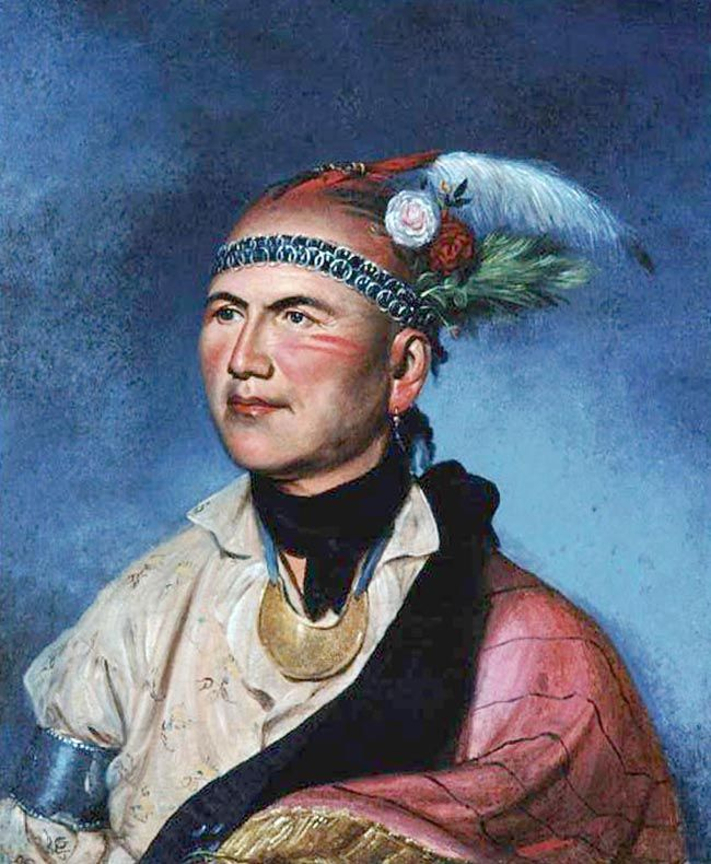Painting of Joseph Brant/Thayendanegea (1742-1807)  Charles Willson Peale, c. 1797  n this portrait, Peale emphasizes Brant's role as a negotiator, rather than as a warrior. Brant's trade silver armband (probably engraved with the Seal of the United States) and his half-moon gorget (likely an earlier gift from the British government) clearly represent the subject's diplomatic alliances. As a man of peace, Brant wears a floral headdress and carries no weapons.