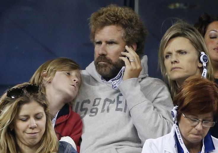 Celebs on the sidelines Will Ferrell listens to a radio as he watches an evening match with his son and wife Viveca Paulin at the 2014 U.S. Open tennis tournament in New York, August 29, 2014.