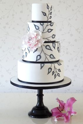 I like this 4-tiered cake. I can't tell if it's leaves or a type of flower hand painted on.
