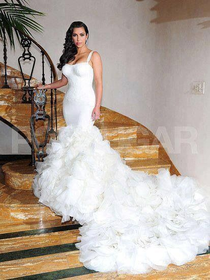 This ladies and gents is my DREAM dress.. this is how i want to look on my wedding day! perfect dress!!!! Kim kardashian  wedding dress. So elegant