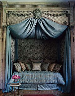 "The ""Liaisons Dangereuses"" Room: The alcove bed had been neon pink; Kohle Yohannan restored its Louis XV– style glory. The wall hangings and curtains were achieved with ""a staple gun,"" he says. ""You can change the world with a staple gun and a hot-glue gun."""