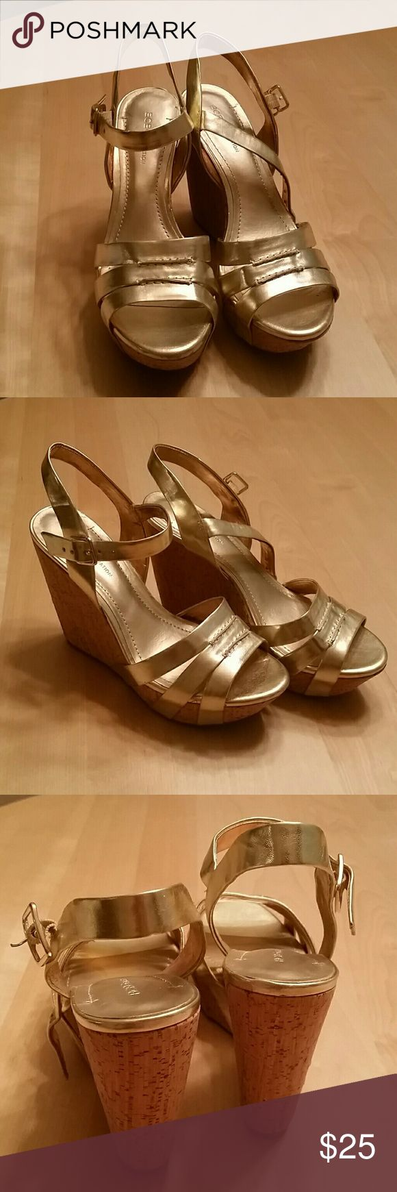 BCBG gold wedge sandals, size 9 BCBG gold, strappy, wedge sandals, size 9. Cork wedge heel, gold straps and buckle. BCBGeneration Shoes Wedges