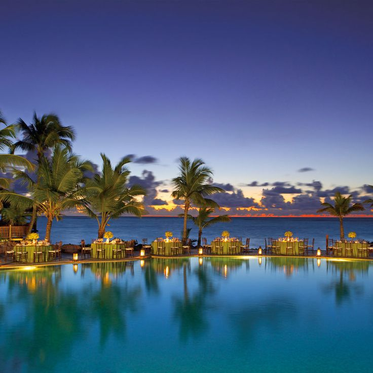 Sanctuary Cap Cana by AlSol Caribbean All-inclusive Exterior Grounds Lounge Luxury Modern Ocean Pool Tropical water sky outdoor reflection tree body of water Lake evening dusk morning arecales Sea flower bay Harbor
