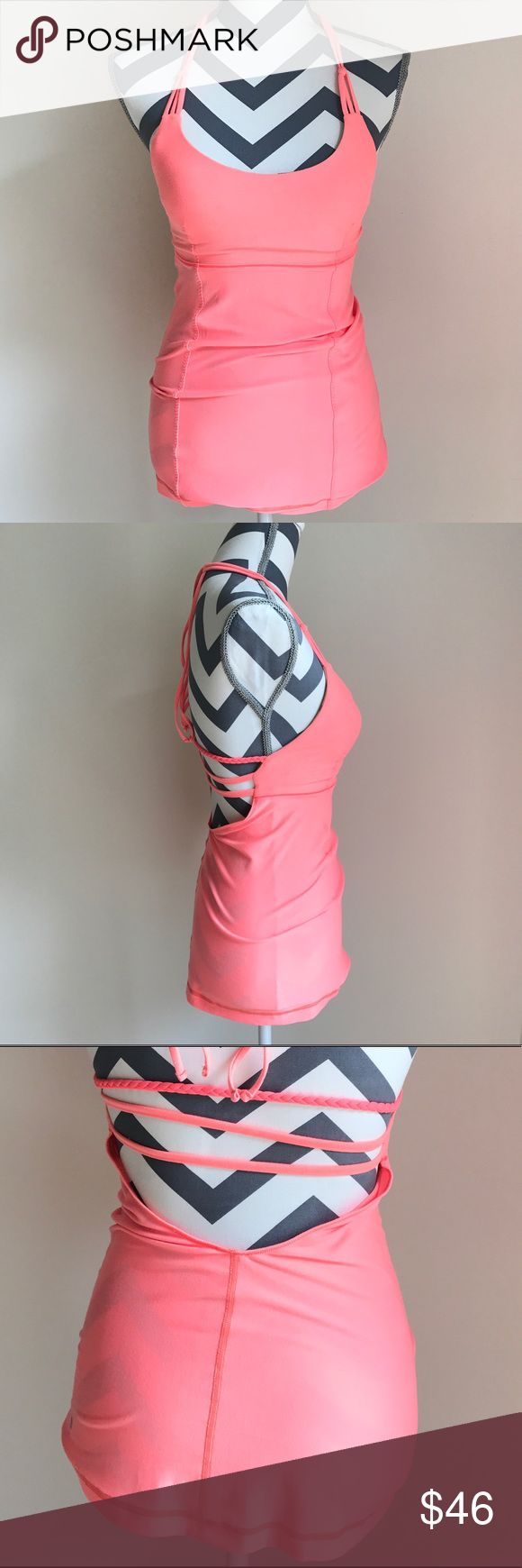 Lululemon Wandering Yogi Halter Grapefruit 4 Like new conditions. Small stitch is cut (IT can bee fix at a lululemon store for free) size 4z Four way stretch fabric. Low back and scoop neck. Cups included lululemon athletica Tops Tank Tops