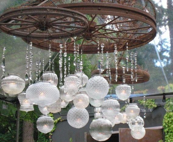 hanging globe wagon wheel chandelier vintage ambiance seattle wedding planner new creations weddings - Wagon Wheel Chandelier