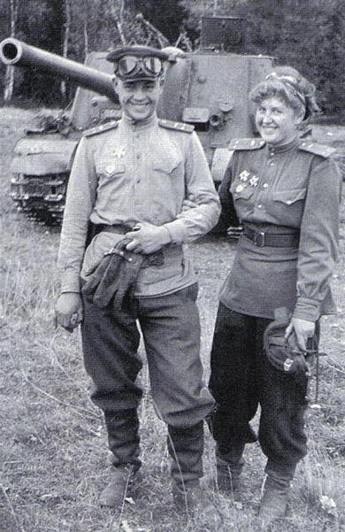 By the summer of 1944, a large number of Russian women were inducted into the Red Army due to a severe shortage of men. A number of women ended up in armor units, after being recruited from tank plants where they worked. They were already well trained as drivers, but some later rose in rank to command tank units. To the right is Guards Lieutenant Verla.P. Orlova who commanded the ISU-122 in the background with her husband Lieutenant Nikolai.N. Orlova who served as the vehicle driver. Their…