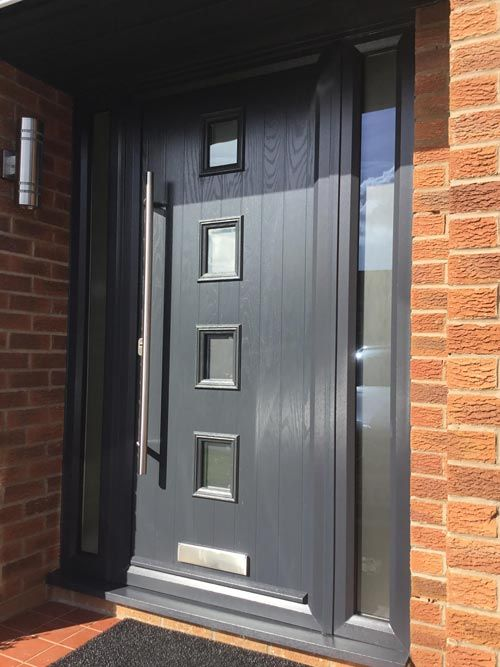 modern front door in grey fitted with contemporary long bar stainless hardware - Modern Exterior Doors