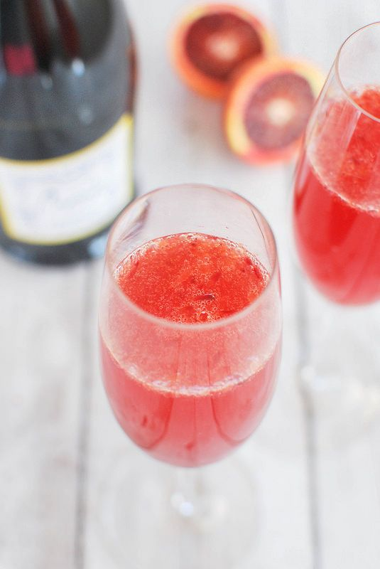 Blood Orange Bellinis - the perfect brunch drink! With black sanding sugar on the rim!