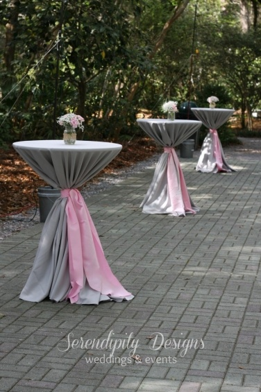 I'd like some taller tables like these in the back with the linens tied around--  maybe one by the photo booth too.