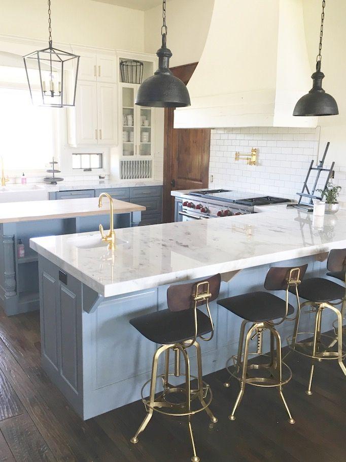Gray kitchen cabinets brass hardware white backsplash