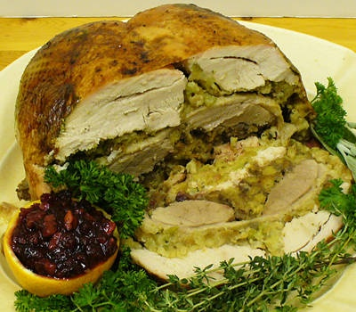 A turducken is a dish consisting of a de-boned chicken stuffed into a de-boned duck, which itself is stuffed into a de-boned turkey. The word turducken is a portmanteau of turkey, duck, and chicken or hen
