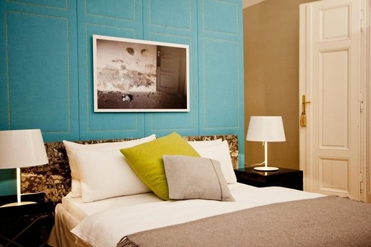 Melissa - this is just to show you how that acid green on the pillow and the blue on the wall work well with the beige you can see on the other walls in this bedroom.
