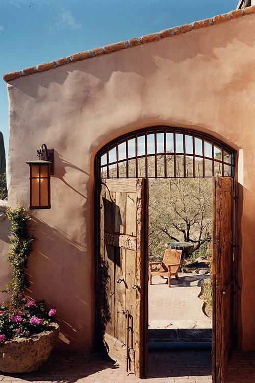 double wood doors open to a welcoming view on the other side of this beautiful southwestern doorssouthwestern stylesouthwest decorhacienda