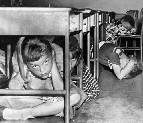 Cold War Air Raid Drill ~ by GX Robinson. (Yes, we hid under our desks. So atomic bombs wouldn't kill us. I think now we were told to do this just so we wouldn't realize how vulnerable we were - so we wouldn't go mad thinking about it.)
