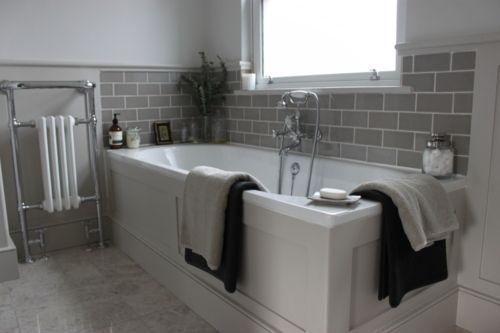 Grey tiled bathroom - Like the subway glass tiles above the tub
