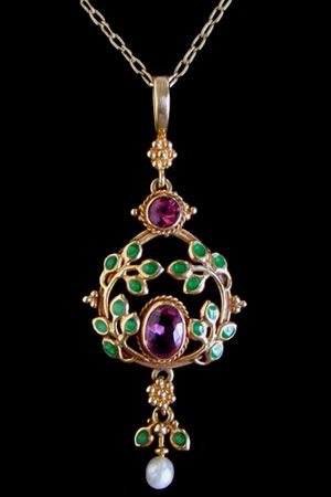 Another sufragette pendant - see the purple and green colours of the sufragette movement.. Liberty - Jessie M King c1900