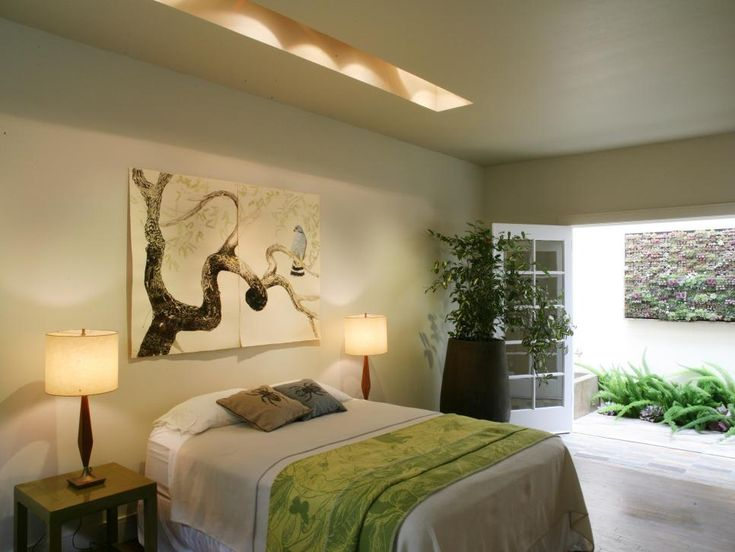 French Doors Open To An Outdoor Garden Area Directly Off Of This Bedroom. A  Large Painting Of A Tree Branch And A Skylight Accent The Natural Feeling  Of The ...