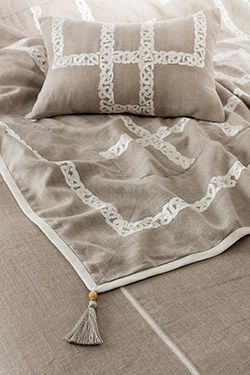 Celtic interlace patterns beautifully hand embroidered on linen, with a silken reverse and tassels. Aztaro throw £1275 | Available to buy from http://www.luxdeco.com/brands/aztaro
