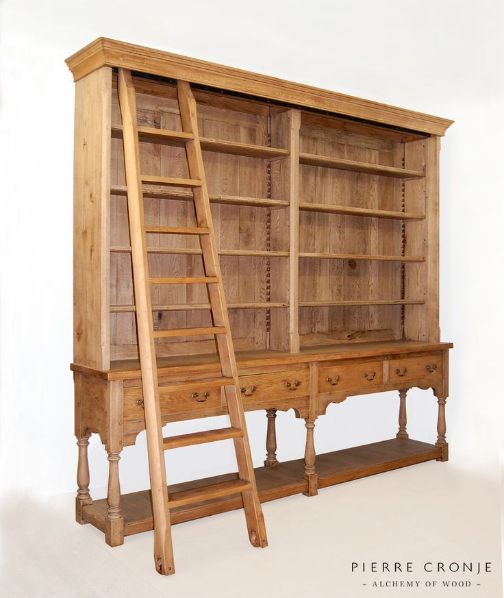 A Pierre Cronje Artois Bookcase in French Oak - sliding ladder, turned legs, four drawers, and a planked shelf below. A superb unit to have in your home office or library.