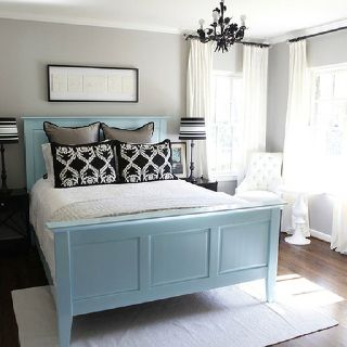 Cool greys and blues, three layers of cushy pillows, soft rug half under the bed.  Soothing guest room.