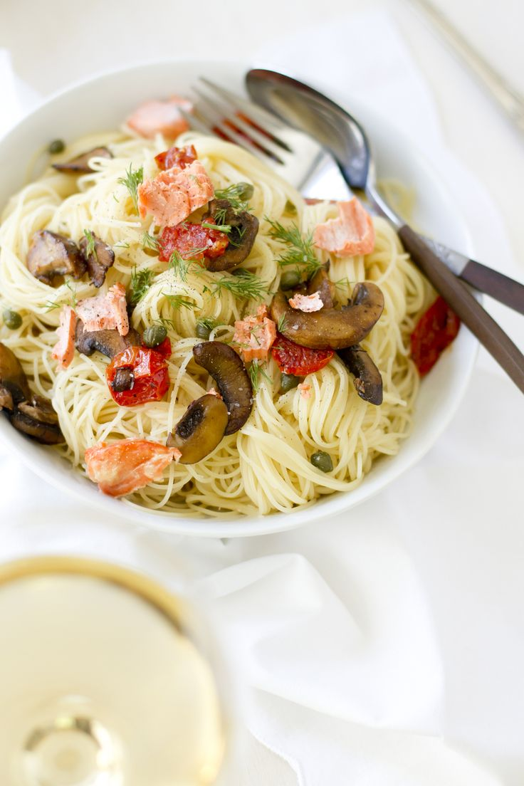 Capellini Pasta with Salmon and Mushrooms -  ¼ cup olive oil 1 12oz. salmon filet, cut into ½ inch pieces 4 garlic cloves, minced ½ lbs. Mushrooms, sliced ½ cup grape tomatoes, halved ⅓ cup dry white wine 3 tbs. capers ½ lb. Capellini, cooked to al dente ¼ cup fresh dill 1 tbs. lemon juice