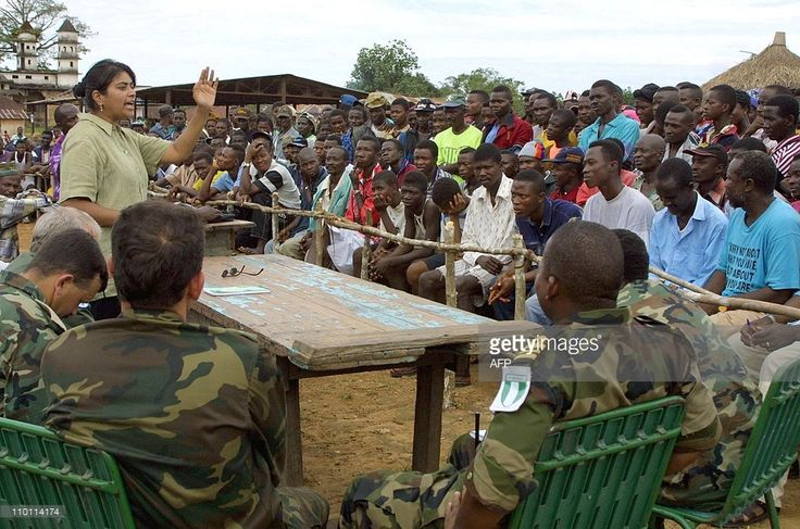 Raja Jandhyala , a coordinator for the National Commission for Disarmement, Demobilization and Reinstatement , addresses fighters and commanders of the Revolutionary United Front 14 November 2001 in Kailahun, eastern Sierra Leone, during a meeting with United Nations observers focused on the disarmement in the Kailahun district. This district is the last to operate disarmement in Sierra Leone. Following the signature of an agreement in May 2001 between the government, the RUF and the UN…