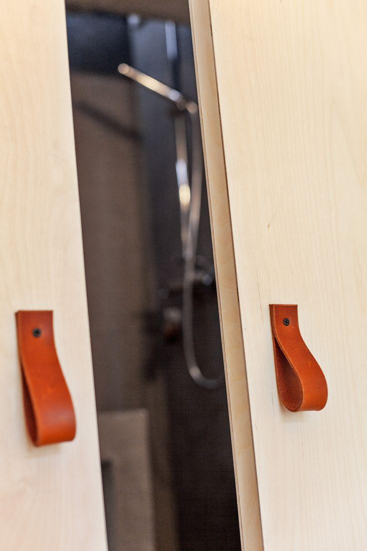 Leather handles, playwood slidingdoor. Architect/designer, Lisa Wettsjö+Gustav Wettsjö